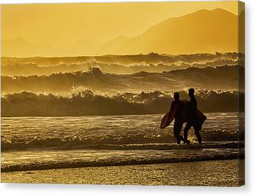 Body Surfers Walk In The Water Canvas Print