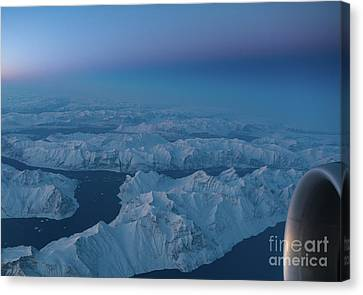 Boeing 777 Flying Over Greenland Fjords Canvas Print by Mike Reid