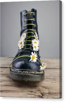 Boots With Daisy Flowers Canvas Print by Nailia Schwarz