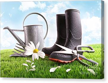 Boots With Watering Can And Daisy In Grass  Canvas Print by Sandra Cunningham