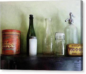 Bottles And A Coffee Can Canvas Print by Susan Savad