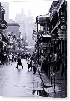 Bourbon Street In The Rain Canvas Print by Ray Devlin