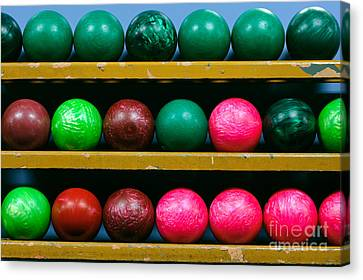 Bowling Balls In Ball Rack Canvas Print by Paul Velgos