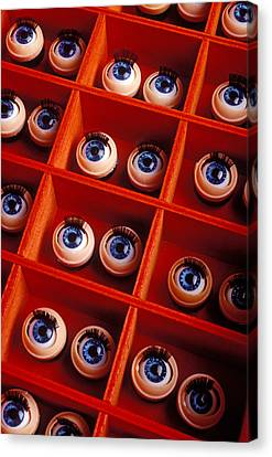 Box Full Of Doll Eyes Canvas Print by Garry Gay