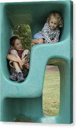 Boy And Girl Playing In Plastic Cube Canvas Print