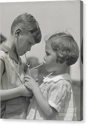 Sharing Canvas Print - Boy And Girl Sharing A Drink, C. 1930s by H. Armstrong Roberts/ClassicStock