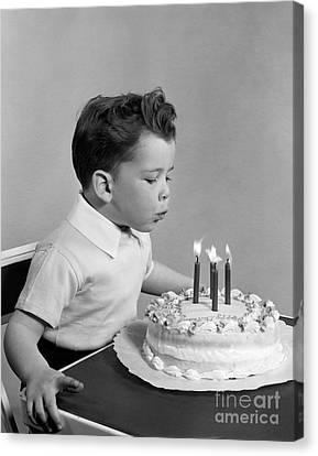 Boy Blowing Out Candles On Cake, C.1950s Canvas Print by H. Armstrong Roberts/ClassicStock
