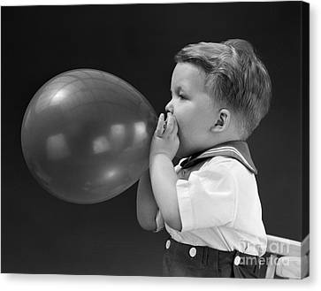 Blows Air Canvas Print - Boy Blowing Up Balloon, C.1940s by H. Armstrong Roberts/ClassicStock