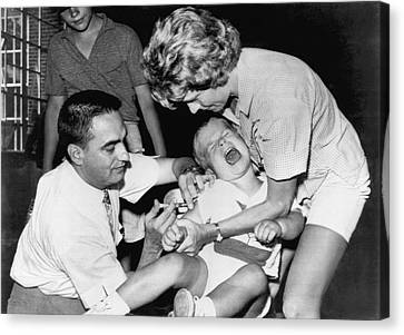 Boy Gets Measles Vaccine  Shot Canvas Print by Underwood Archives