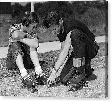 Boy Helping Girl With Roller Skates Canvas Print by H. Armstrong Roberts/ClassicStock