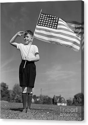 Boy Holding American Flag & Saluting Canvas Print by H. Armstrong Roberts/ClassicStock