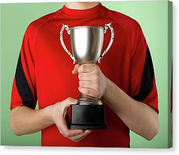 Boy Holding Trophy Canvas Print by Jeffrey Coolidge