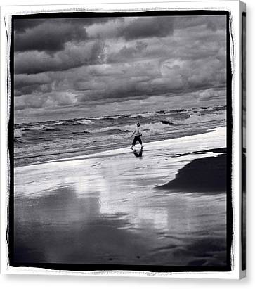 Boy On Shoreline Canvas Print by Steve Gadomski