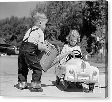 Boy Playing Gas Station Attendant Canvas Print by H. Armstrong Roberts/ClassicStock