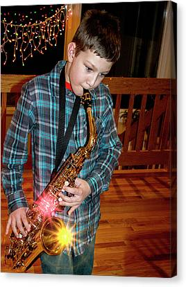 Boy Playing The Saxophone Canvas Print