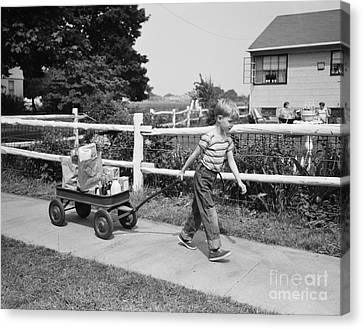 Boy Pulling Groceries In Wagon, C.1950s Canvas Print