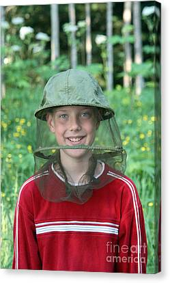 Boy With A Bug Net Hat Canvas Print by Ted Kinsman