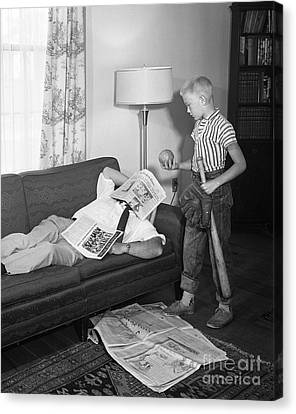 Boy With Baseball Vs. Napping Dad Canvas Print by D. Corson/ClassicStock