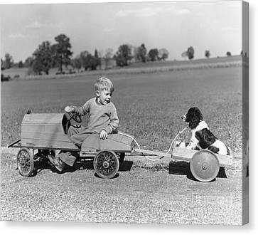 Boy With Canine Cargo, C.1930-40s Canvas Print by H. Armstrong Roberts/ClassicStock