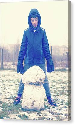 Boy With Snowman Canvas Print