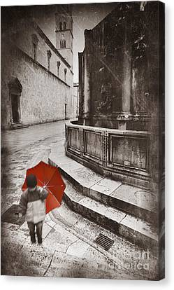 Boy With Umbrella Canvas Print by Rod McLean