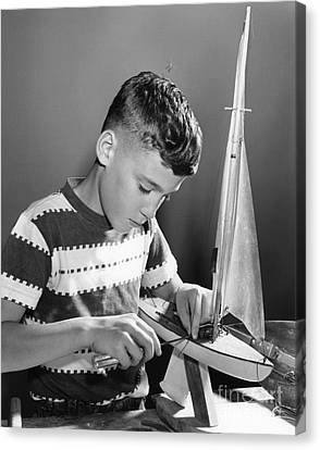 Boy Working On Model Sailboat, C.1950s Canvas Print by H. Armstrong Roberts/ClassicStock