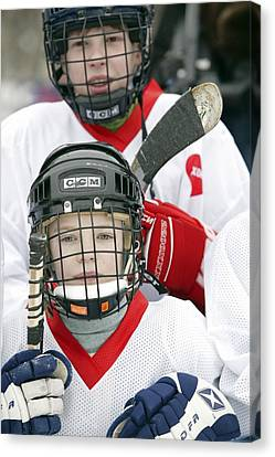 Boys Playing Ice Hockey Canvas Print by Ria Novosti