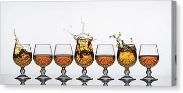 Brandy Glass Splash Canvas Print by Andy Astbury