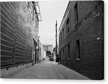 Canvas Print featuring the photograph Brick Building Alley Black And White by Matt Harang