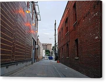 Canvas Print featuring the photograph Brick Building Alley by Matt Harang