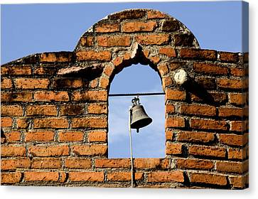 Brick Wall And Bell Canvas Print by Xavier Cardell