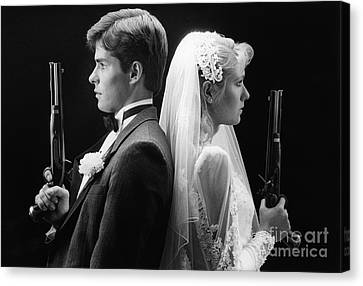 Bride And Groom With Dueling Pistols Canvas Print by H. Armstrong Roberts/ClassicStock