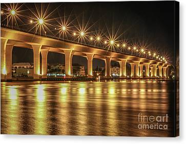 Bridge And Golden Water Canvas Print by Tom Claud