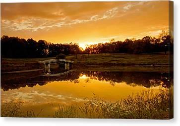 Bridge At Sundown Canvas Print by Keith Bridgman