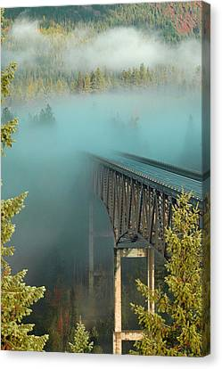 Bridge In The Mist Canvas Print by Annie Pflueger