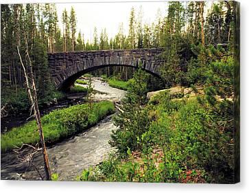 Bridge Over A Stream   Canvas Print by Jeff Swan