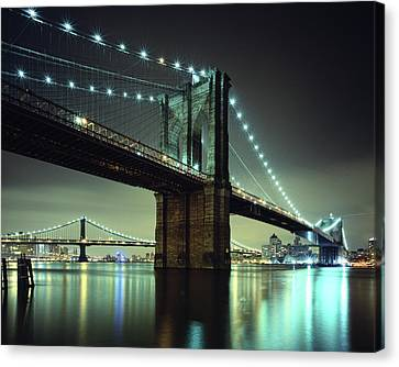 Brooklyn Bridge At Night, New York City Canvas Print by Andrew C Mace