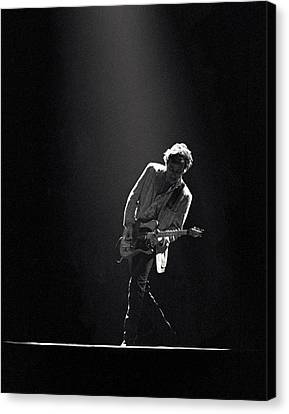 Bruce Springsteen In The Spotlight Canvas Print by Mike Norton
