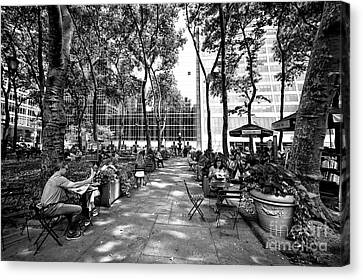 Canvas Print featuring the photograph Bryant Park Reading by John Rizzuto