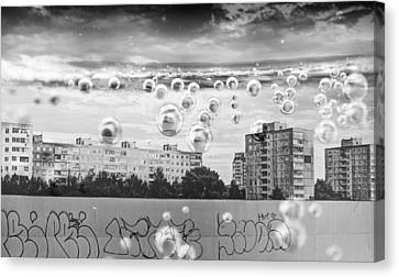 Bubbles And The City Canvas Print by John Williams