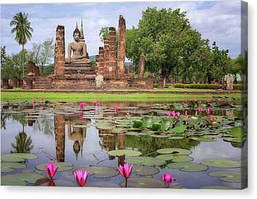 Buddha Statue At Wat Mahathat In Sukhothai  Canvas Print by Anek Suwannaphoom