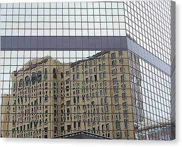Building Reflection Canvas Print by Jean Booth