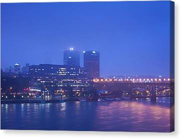 Buildings At The Riverside Lit Canvas Print by Panoramic Images