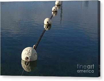 Canvas Print featuring the photograph Buoys In Aligtnment by Stephen Mitchell