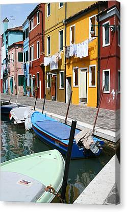 Canvas Print featuring the photograph Burano Corner With Laundry by Donna Corless