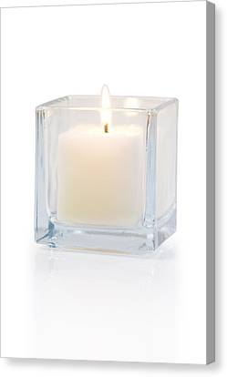 Burning Candle Side View 20 Degree Canvas Print by Atiketta Sangasaeng