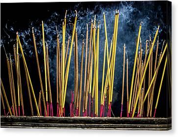 Burning Joss Sticks Canvas Print by Hitendra SINKAR