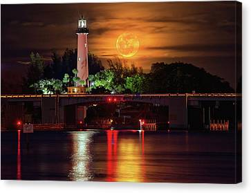 Burning Moon Rising Over Jupiter Lighthouse Canvas Print by Justin Kelefas