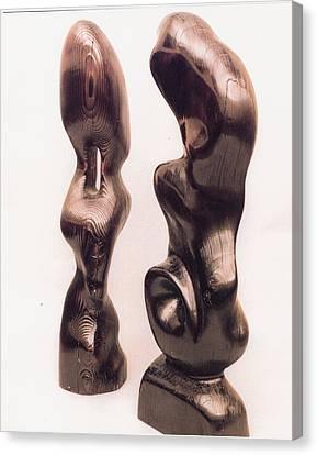 Burnt Sculptures Pair Canvas Print by Lionel Larkin