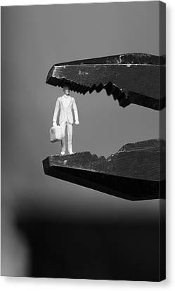 Business Man Under Pressure In Pliers - Monochrome Canvas Print